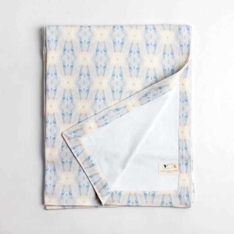 Luxury organic periwinkle blue diamond knit throw folded over