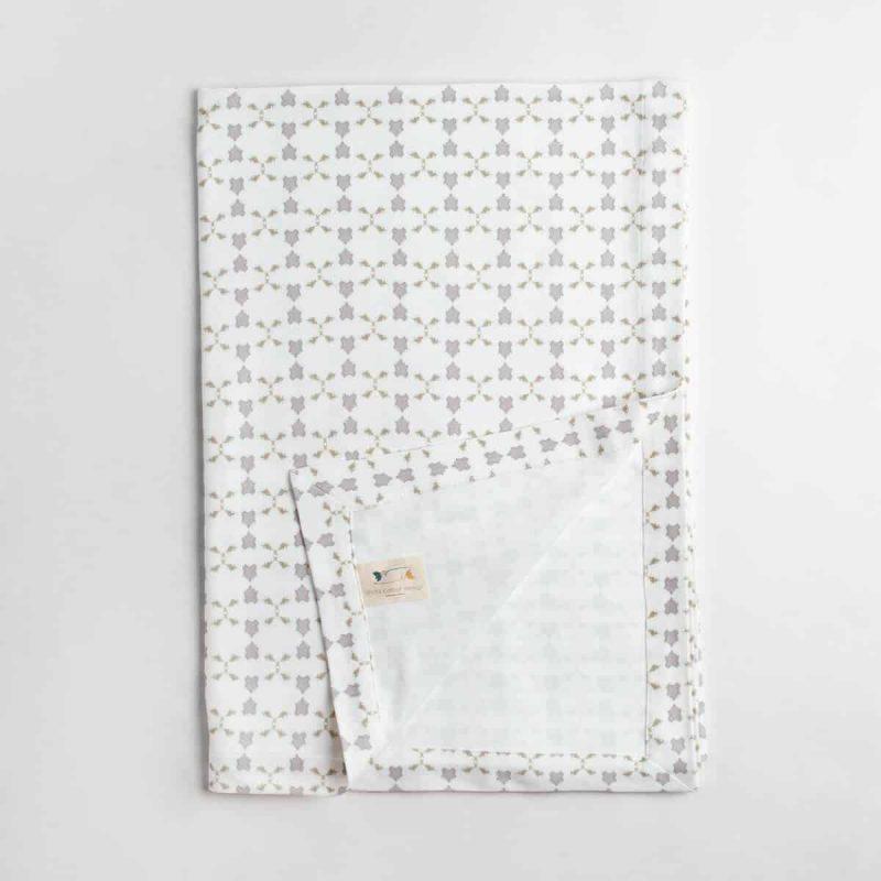 Luxury organic neutral cross stitch geometric pattern knit throw folded over
