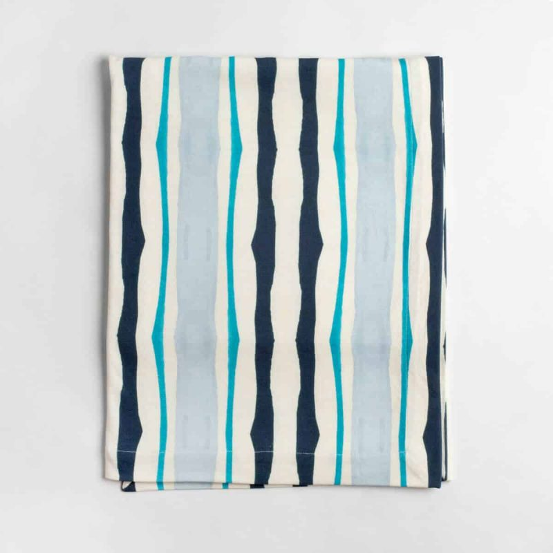 Luxury organic navy and blue mirrored watercolor stripe knit throw folded over
