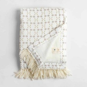 Luxury organic neutral cross stitch geometric pattern plush lined throw with hand knotted fringe folded over