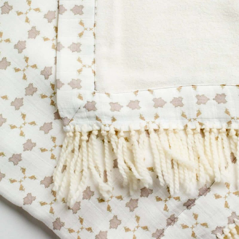Luxury organic neutral cross stitch geometric pattern plush lined throw with hand knotted fringe detail