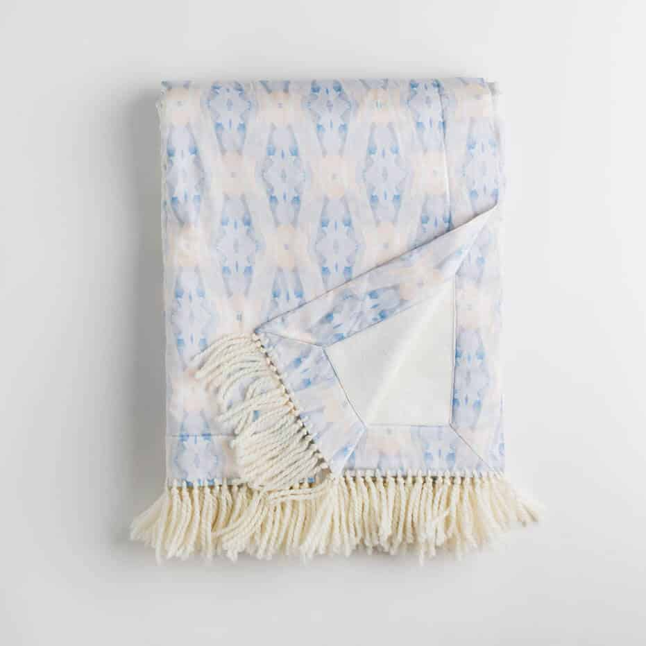 Luxury organic periwinkle blue diamond plush lined throw with hand knotted fringe folded over