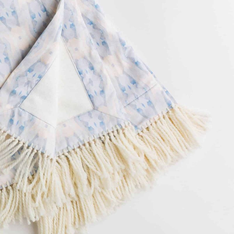 Luxury organic periwinkle blue diamond plush lined throw with hand knotted fringe detail