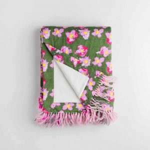 Luxury organic pink and green flower plush lined throw with hand knotted fringe folded over