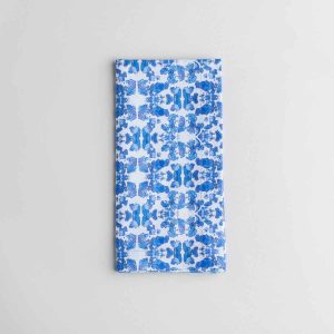 Luxury organic abstract tessellating floral blue dinner napkin folded