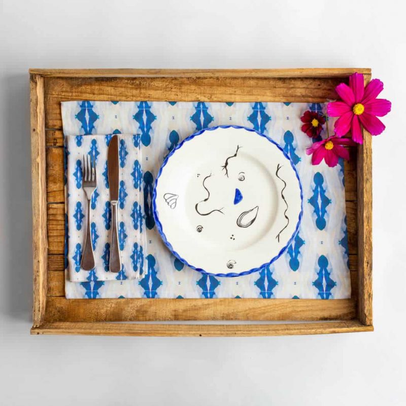 Luxury organic blue diamond placemat place setting with shell plate and pink flowers