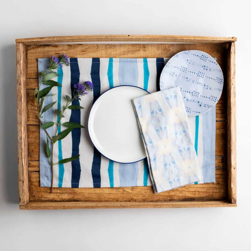 Luxury organic navy and blue mirrored watercolor stripe placemat place setting with napkins two plates and purple flower