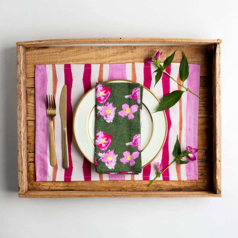 Luxury organic pink and orange mirrored watercolor stripe placemat place setting with gold silverware and pink flowers