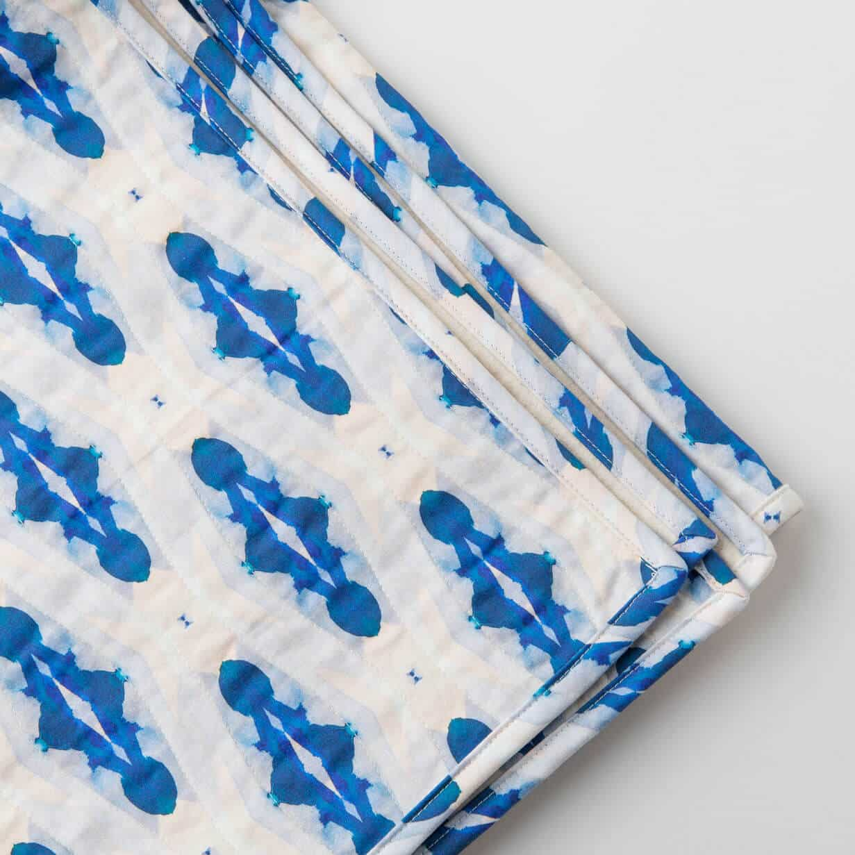 Luxury organic blue diamond quilted coverlet detail