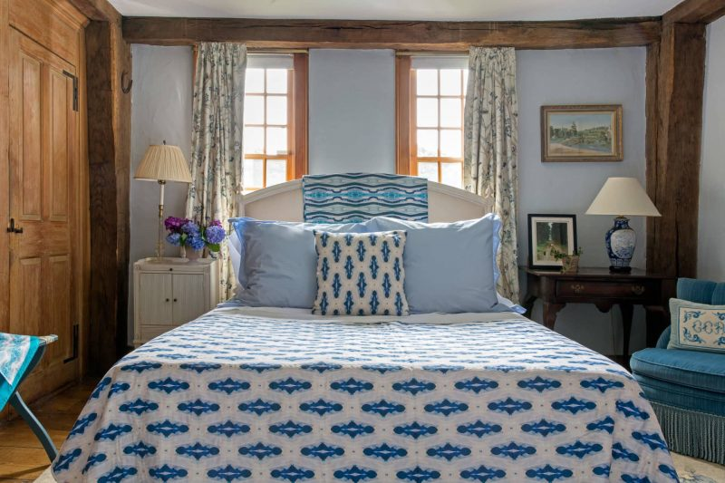 Light blue bedroom with organic diamond pattern quilt and pillow on the bed
