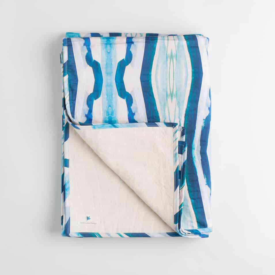 Luxury organic turquoise mirrored diamond quilted coverlet folded over