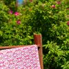 Luxury organic abstract tessellating floral pink quilted coverlet with beach roses background