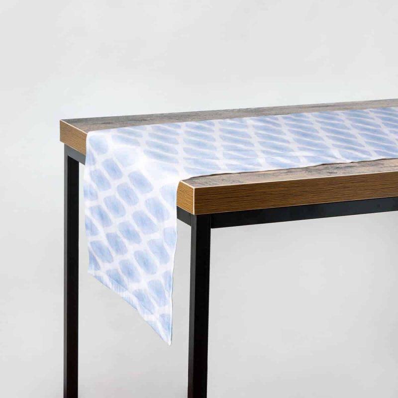 Luxury organic periwinkle diamond lattice table runner hanging on a table