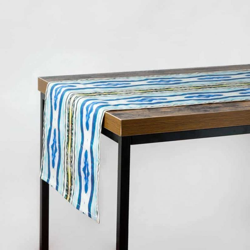 Luxury organic abstract watercolor stripe tabble runner hanging off a table