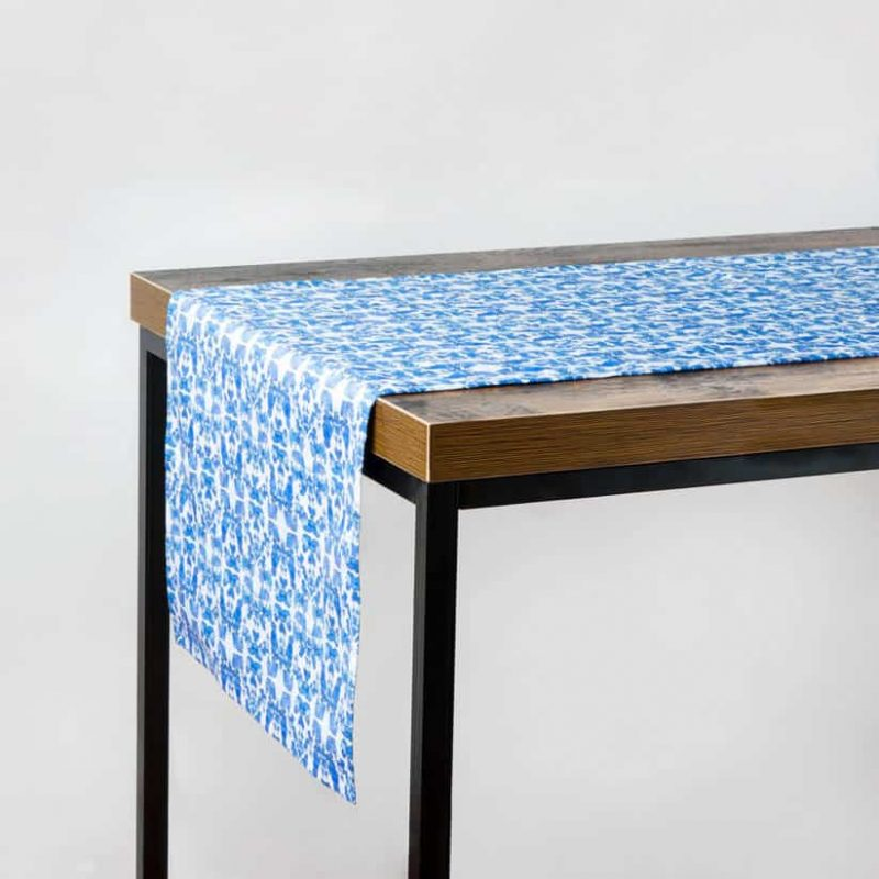 Luxury organic abstract tessellating floral blue table runner hanging off table
