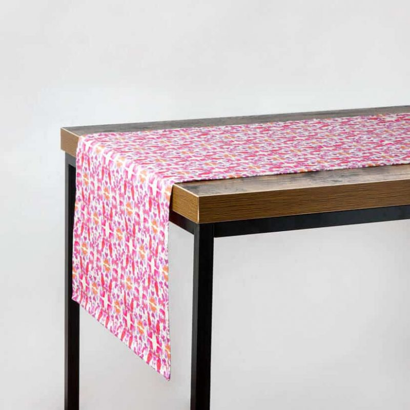 Luxury organic abstract tessellating floral pink table runner hanging off table