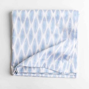 Luxury organic periwinkle diamond lattice tablecloth folded