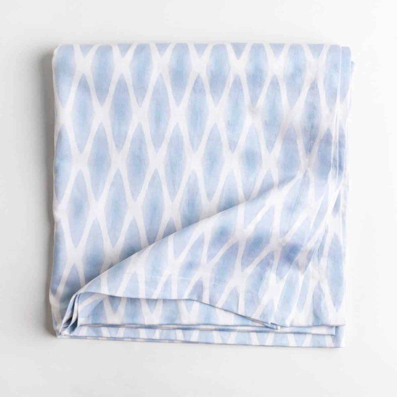 Luxury organic periwinkle diamond lattice tablecloth folded