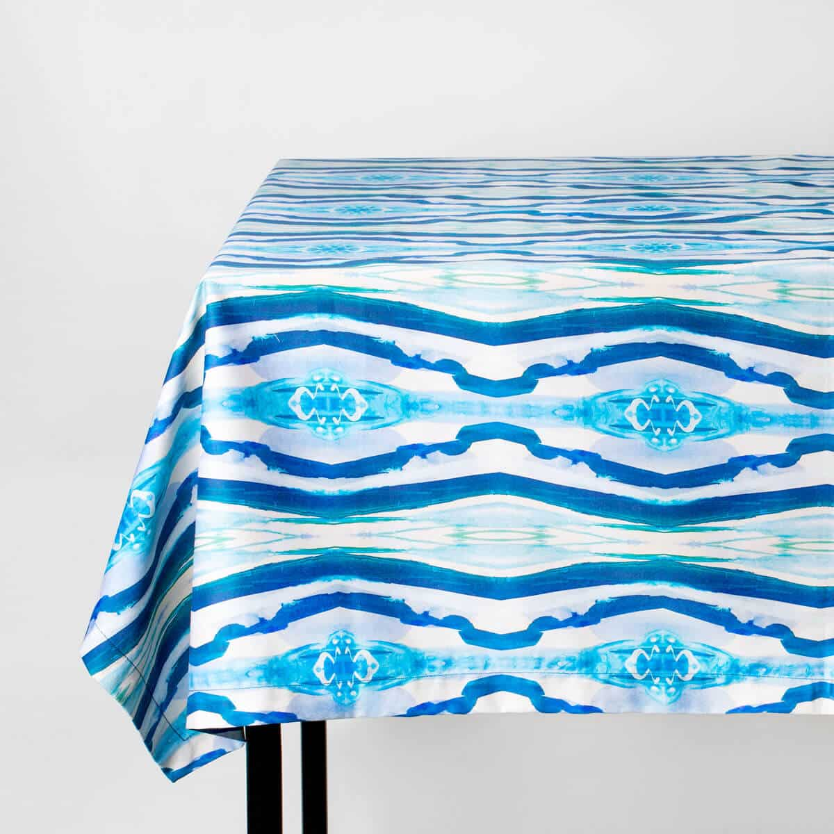 Luxury organic turquoise mirrored diamond tablecloth draped over a table