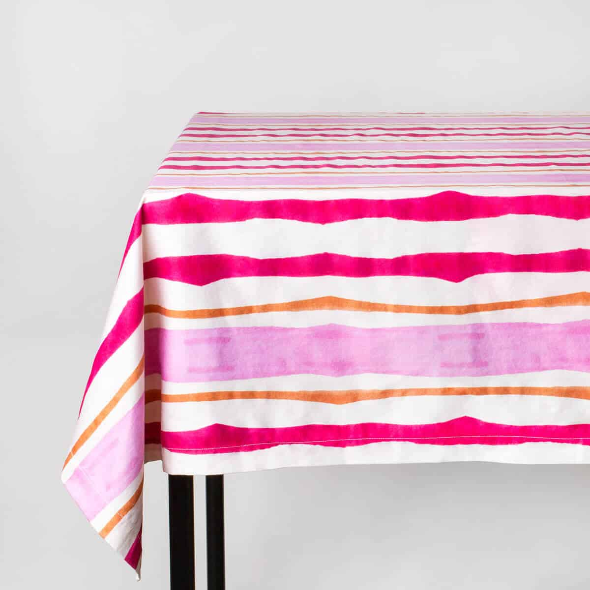 Luxury organic pink and orange mirrored watercolor stripe tablecloth on table