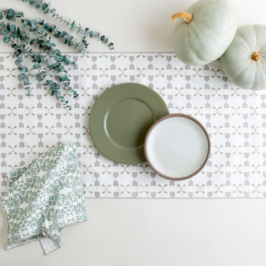 White gray and gold table runner with autumn place setting