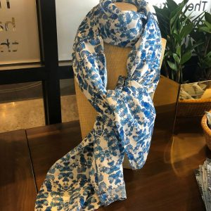 Blue and white Tencel scarf on display stand