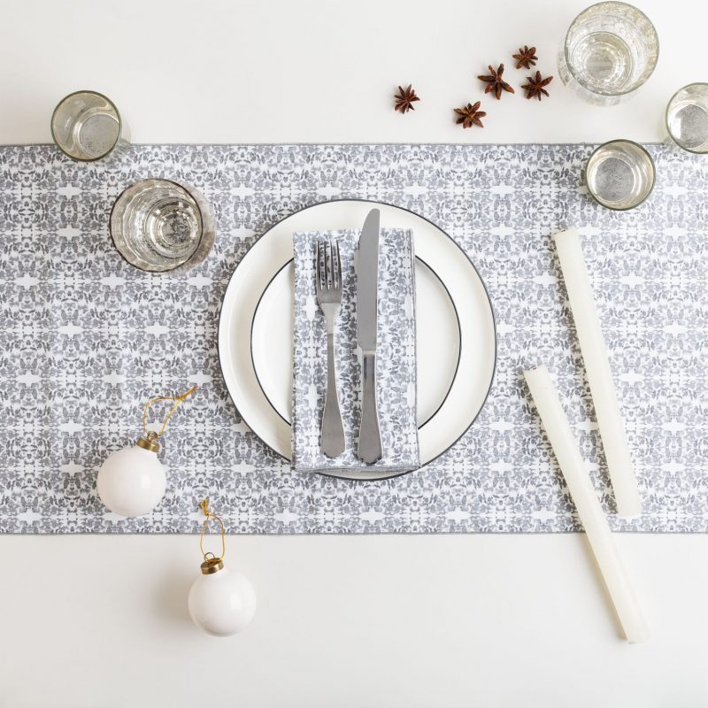 Graphite and white organic cotton table runner with silver holiday table setting