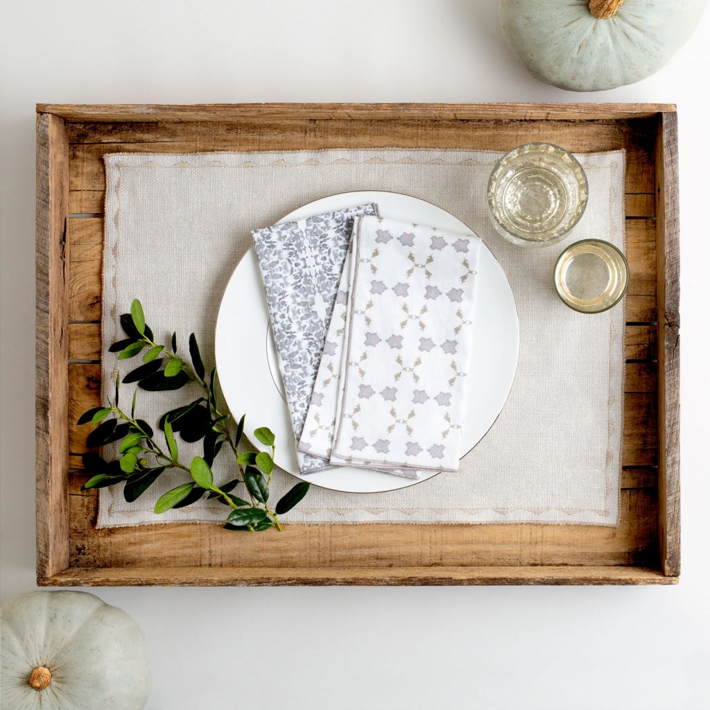 Gray linen placemat with white and gray napkins