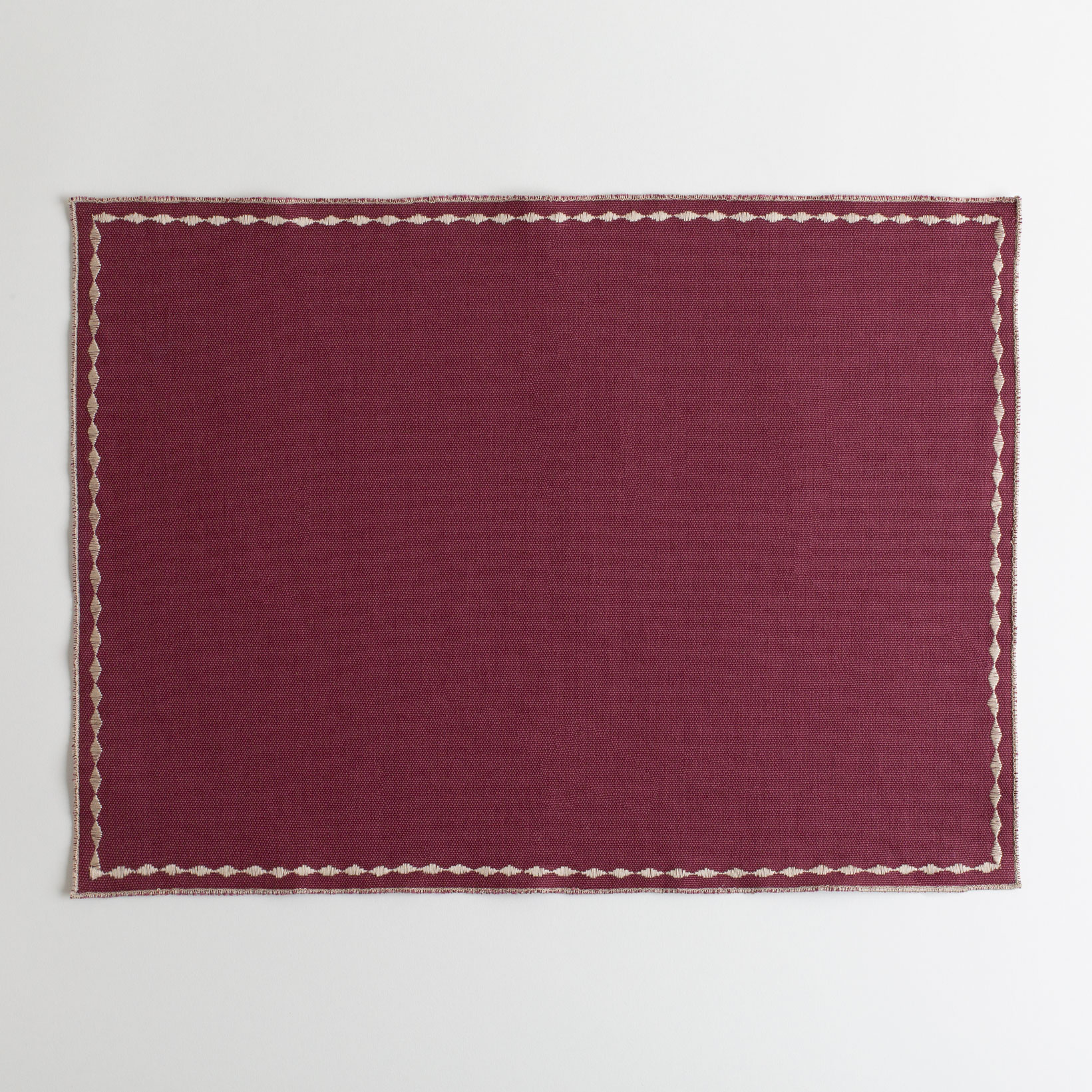 Merlot placemat with decorative stitching