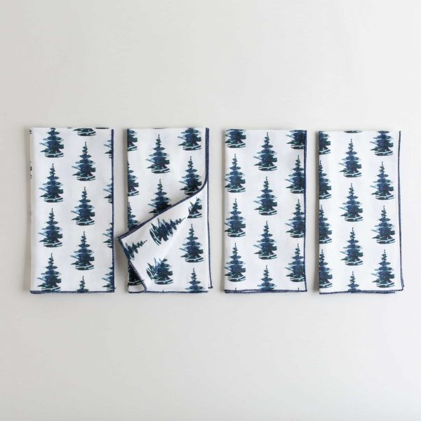 Organic white cotton napkin with a pine tree print
