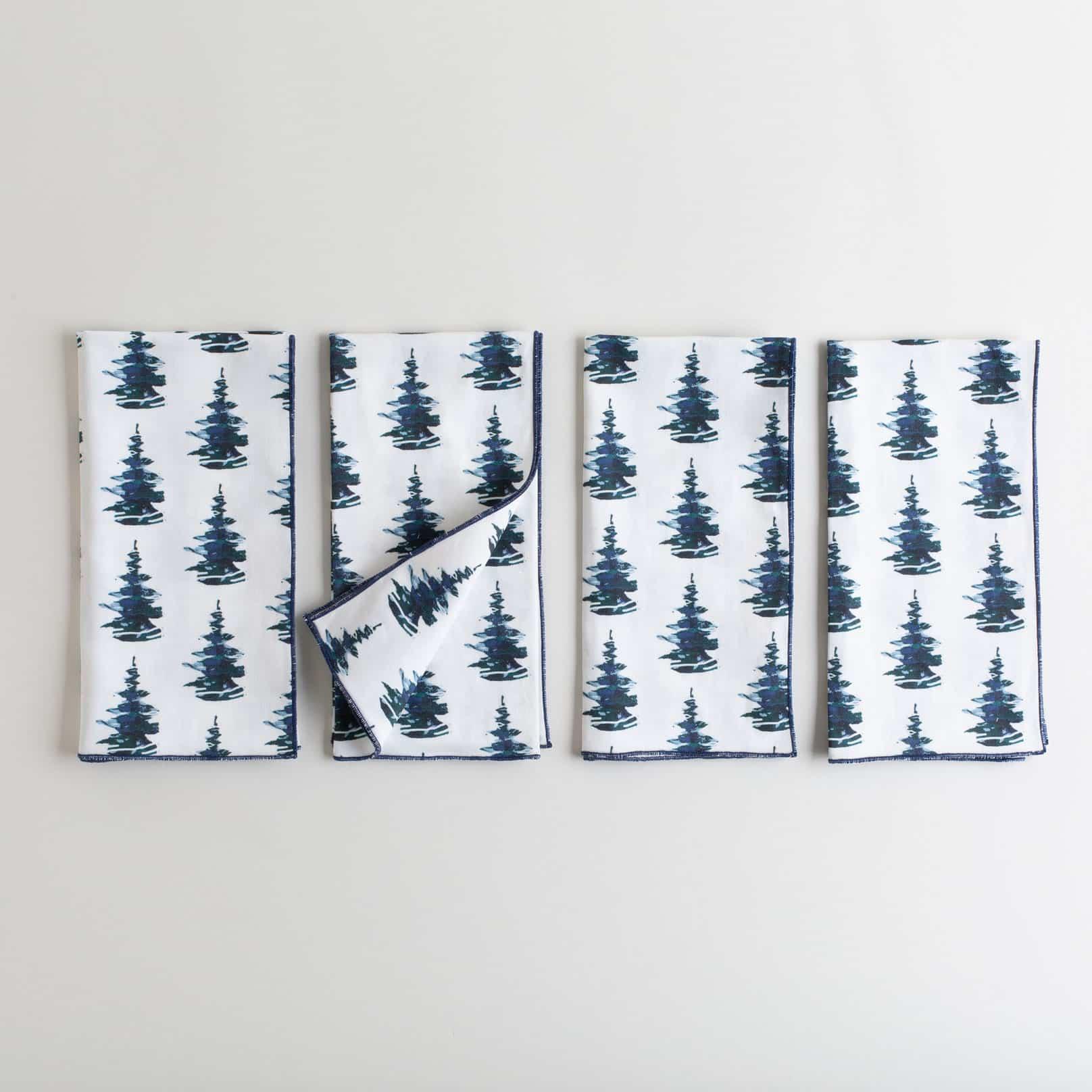 Organic white cotton napkin with a pine tree print
