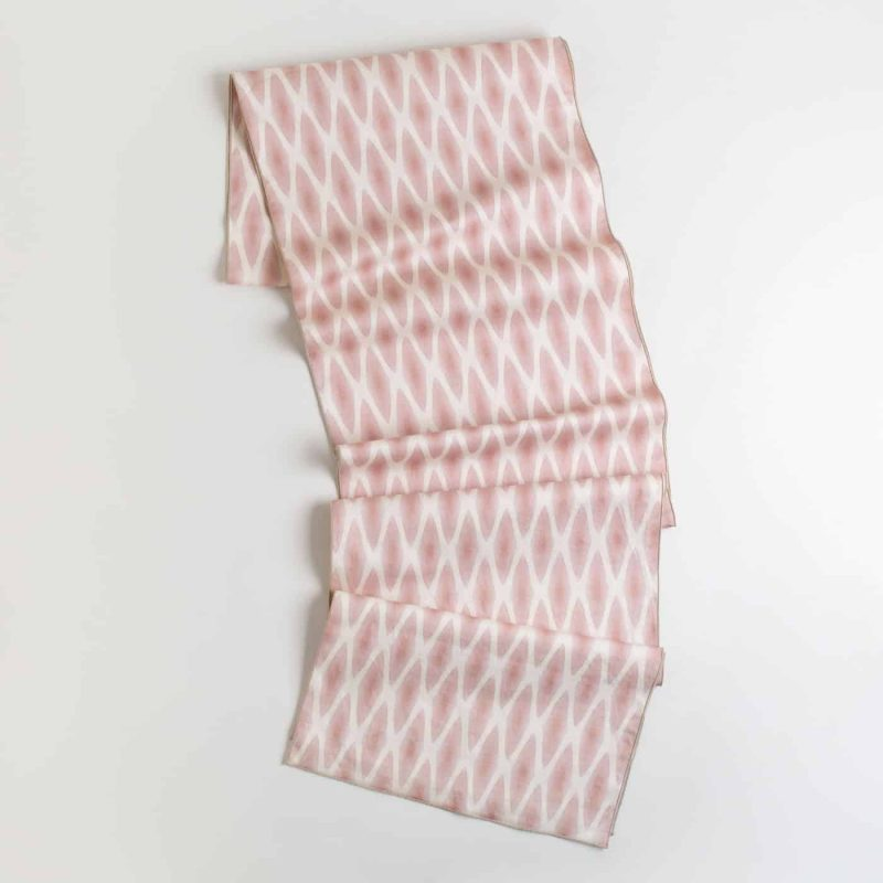 Pink and white patterned organic cotton table runner