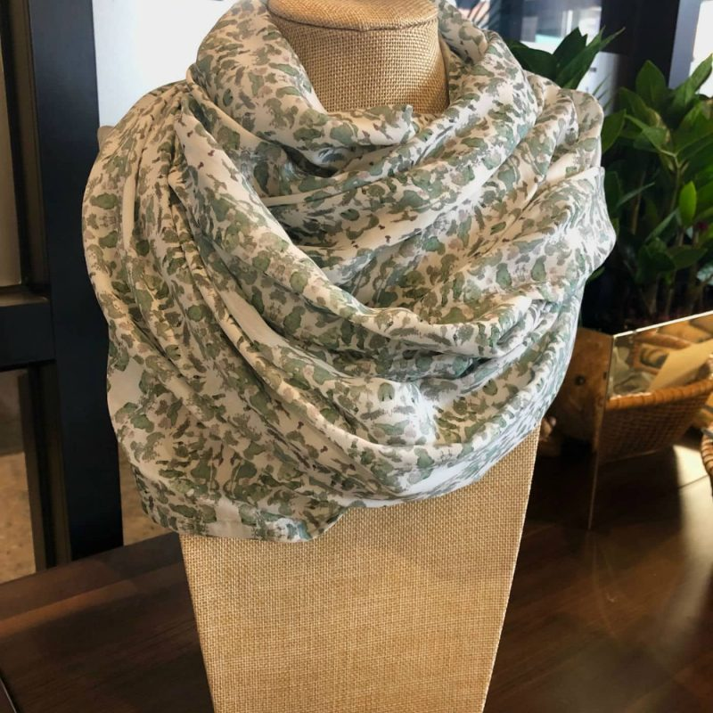 Sage and white Tencel scarf on display stand