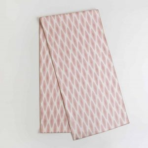 Pink and white patterned table runner