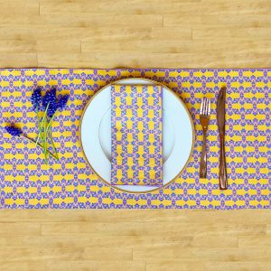 Yellow sustainable table runner and napkin