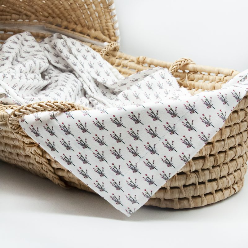 white floral organic baby blanket and burp cloths