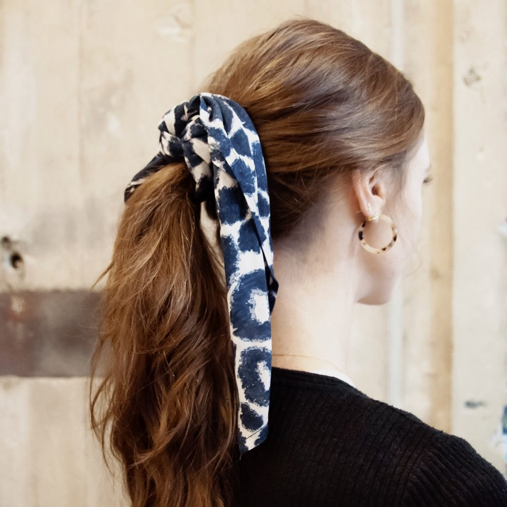 cheetah print square scarf styled as a hair tie