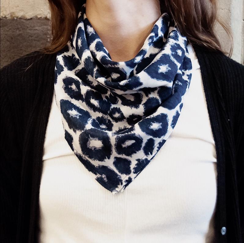 cheetah print bandana tied around the neck