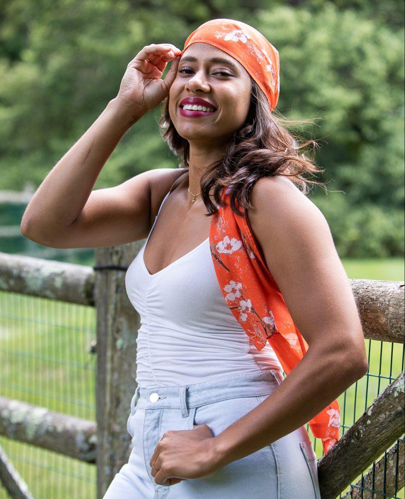 orange floral tencel scarf styled around the head